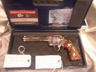 4 150  COLT PYTHON ELITE  NEW  UNFIRED   357    6   SS   TWO PAIR OF CHECKERED WALNUT GRIPS     EXTRAS
